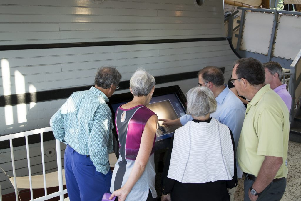 Members of the public playing with the touchscreen at a Vancouver Maritime Museum event. (Photo by Lizzie Brotherston, Vancouver Maritime Museum)